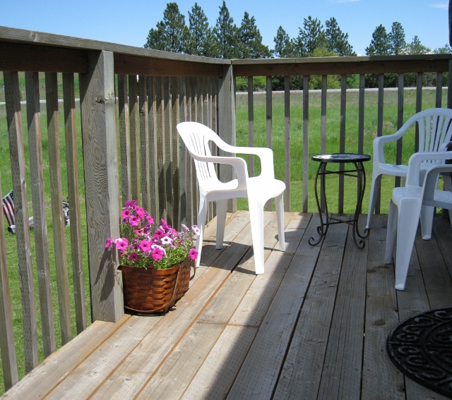 Enjoy viewing the prairie lands by day & stars by night from the private deck